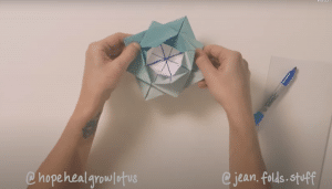 Jean shows completed lotus flower activity