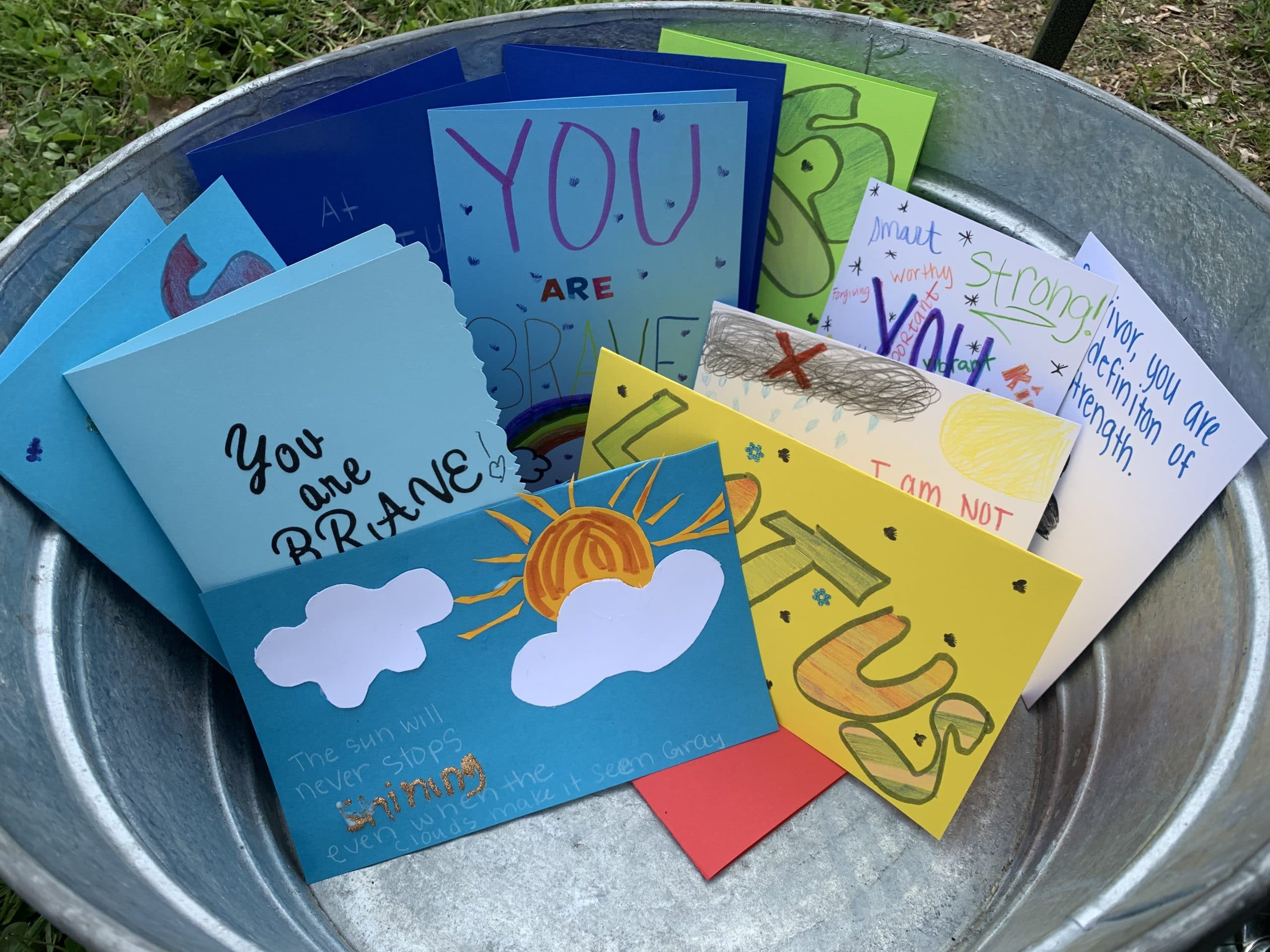 Cards with messages of support for survivors in a metal tub