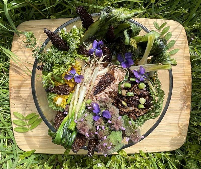 Wild foraged ramen bowl on cutting board